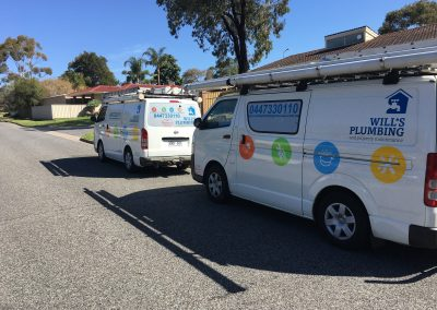 Will's Plumbing two service van hitting the road